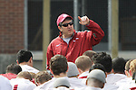 Mike Leach, head football coach at Washington State, talks to his troops following a spring practice at Rogers Field on the WSU campus in Pullman, Washington, on March 24, 2012.