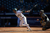Ricky Martinez (11) of the Baylor Bears follows through on his swing against the Missouri Tigers in game one of the 2020 Shriners Hospitals for Children College Classic at Minute Maid Park on February 28, 2020 in Houston, Texas. The Bears defeated the Tigers 4-2. (Brian Westerholt/Four Seam Images)