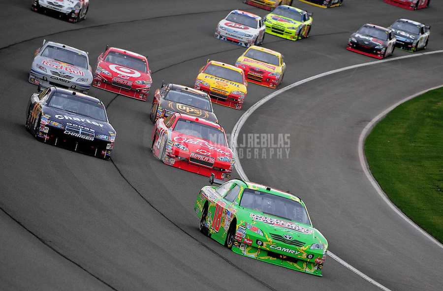 Feb 22, 2009; Fontana, CA, USA; NASCAR Sprint Cup Series driver Kyle Busch leads a pack of cars during the Auto Club 500 at Auto Club Speedway. Mandatory Credit: Mark J. Rebilas-