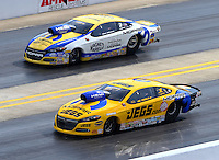 Sep 13, 2014; Concord, NC, USA; NHRA pro stock driver Jeg Coughlin Jr (near) races alongside Allen Johnson during qualifying for the Carolina Nationals at zMax Dragway. Mandatory Credit: Mark J. Rebilas-USA TODAY Sports