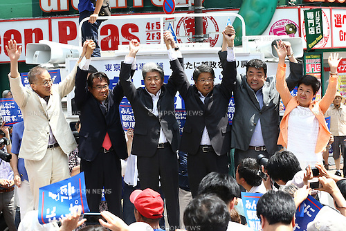 The opposition parties member attend a stump speech to support Shuntaro Torigoe, journalist and a joint candidate of opposition parties in front of Shinjuku Station, Tokyo, Japan on July 14, 2016. Official election campaign was kicked off on Thursday for the July 31 Tokyo gubernatorial election. (Photo by Shingo Ito/AFLO)