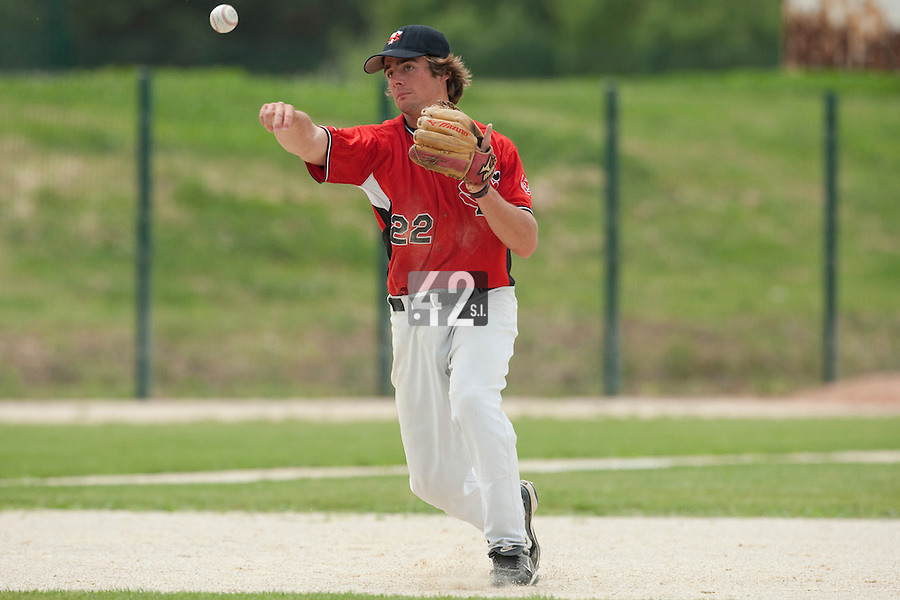 21 May 2009: Arthur Paradinas of Toulouse throws a ball to first base during the 2009 challenge de France, a tournament with the best French baseball teams - all eight elite league clubs - to determine a spot in the European Cup next year, at Montpellier, France.