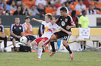 New York Red Bulls midfielder Dax McCarty (11) shields the ball from D.C. United midfielder Marcelo Saragosa (11) The New York Red Bulls tied D.C. United 2-2 at RFK Stadium, Wednesday August 29, 2012.