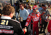 Feb 08, 2009; Daytona Beach, FL, USA; NASCAR Sprint Cup Series driver Tony Stewart (right) is congratulated by Bill Elliott following qualifying for the Daytona 500 at Daytona International Speedway. Mandatory Credit: Mark J. Rebilas-