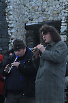 Newgrange Co Meath, 21th December winter solstice, No sun rise this year but a blanket of snow decended on the Tomb in Co Meath. Paul Carolan and Aonghus Óg from Navan playing the tin whistle..Picture Fran Caffrey /www.newsfile.ie.