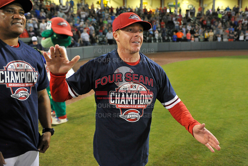 Manager Darren Fenster of the Greenville Drive celebrates the 2017 South Atlantic League Championship following an 8-3 win over the Kannapolis Intimidators in Game 4 of the Championship Series on Friday, September 15, 2017, at Fluor Field at the West End in Greenville, South Carolina. It was Greenville's first SAL Championship. Greenville won the series 3-1. Hitting coach Wilton veras is at left. (Tom Priddy/Four Seam Images)