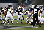Nevada running back Don Jackson runs past UC Davis defender Inoke Raikadroka (75) during an NCAA college football game in Reno, Nev. on Thursday, Sept. 3, 2015. (AP Photo/Cathleen Allison)