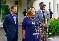 Alveda King, center, flanked by Reverend Dean Nelson, left, and Bishop Harry Jackson, right, speak to the media after meeting with United States President Donald J. Trump at the White House in Washington, DC on Monday, July 29, 2019. Photo Credit: Ron Sachs/CNP/AdMedia