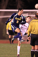 November 13, 2008: University of Michigan's Julian Robles (#3) heads the ball past University or Wisconsin's Brandon Miller (#2) during the firist round of the 2008 Big Ten Tournament.