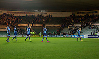 Wycombe Wanderers players clap the travelling fans at full time of the Sky Bet League 2 match between Plymouth Argyle and Wycombe Wanderers at Home Park, Plymouth, England on 26 December 2016. Photo by Mark  Hawkins / PRiME Media Images.