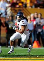Nov. 28, 2009; Tempe, AZ, USA; Arizona Wildcats running back (2) Keola Antolin runs the ball in the second quarter against the Arizona State Sun Devils at Sun Devil Stadium. Mandatory Credit: Mark J. Rebilas-