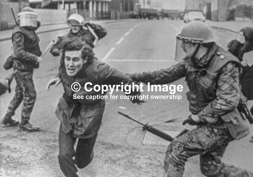 Army snatch squad in action outside a Belfast, N Ireland police station, 10th February 1973. Following an earlier People&rsquo;s Democracy protest march against sectarian killings some of the participants attacked the police station with bottles and stones. 197302100518<br /> <br /> Copyright Image from Victor Patterson, 54 Dorchester Park, Belfast, UK, BT9 6RJ<br /> <br /> t1: +44 28 9066 1296 (from Rep of Ireland 048 9066 1296)<br /> t2: +44 28 9002 2446 (from Rep of Ireland 048 9002 2446)<br /> m: +44 7802 353836<br /> <br /> e1: victorpatterson@me.com<br /> e2: victorpatterson@gmail.com<br /> <br /> The use of my copyright images is subject to my Terms &amp; Conditions.<br /> <br /> It is IMPORTANT that you familiarise yourself with them. They are available on my website at www.victorpatterson.com.<br /> <br /> None of my copyright images may be used on a website unless they are visibly watermarked, i.e. &copy; Victor Patterson within the body of the visible image. Metadata denoting my copyright must NOT be deleted. <br /> <br /> Web use is extra at currently recommended NUJ rates.