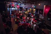 NEW YORK, NY - December 10: Revelers dressed as Santa Claus drink in a bar during the annual SantaCon event in New York City , December 10, 2016.VIEWpress/Maite H. Mateo