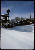 Winter view of Chama coaling tower &amp; sandhouse. Three drop-bottom gondolas and on the refill track.<br /> D&amp;RGW  Chama, NM