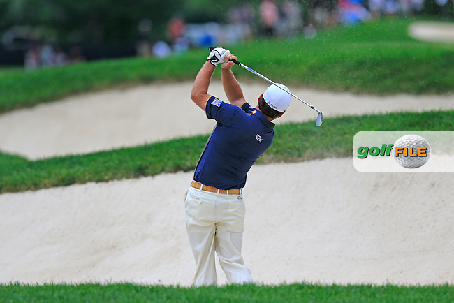 Graeme McDowell (NIR) plays his 2nd shot from a fairway bunker on the 14th hole during Friday's Round 1 of the 2013 Bridgestone Invitational WGC tournament held at the Firestone Country Club, Akron, Ohio. 2nd August 2013.<br /> Picture: Eoin Clarke www.golffile.ie