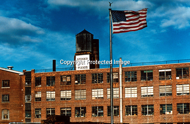 dimuinst00030.Digital. Music. Instruments. The Steinway piano factory building on October 23, 1997 in Queens, close to New York City, New York, USA. The factory was built in 1870 and is still producing the best pianos in the world. Industry, building, American flag, flagpost. .©Per-Anders Pettersson/iAfrika Photos
