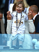 A young Swansea City fan cheers their team on during the Barclays Premier League match between Swansea City and Manchester City played at The Liberty Stadium, Swansea on 15th May 2016