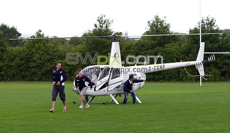 PICTURE BY VAUGHN RIDLEY/SWPIX.COM...Rugby League - 2011 CarPlan International Origin Match - England Media Day - Loughborough University, Loughborough, England - 07/06/11...England's Adrian Morley and Sam Tomkins go for a ride on a helicopter as part of the team's Media Day.  The England squad are due to play the Exiles in the International Origin Match at Headingley, Leeds on Friday, June 10th.