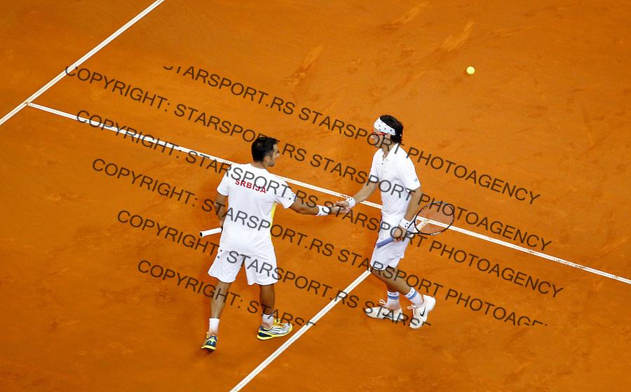 Tennis Tenis<br /> Davis Cup semifinal polufinale<br /> Serbia v Canada<br /> Nenad Zimonjic and Ilija Bozoljac v Daniel Nestor and Vasek Pospisil<br /> Ilija Bozoljac and Nenad Zimonjic<br /> Beograd, 14.09.2013.<br /> foto: Srdjan Stevanovic/Starsportphoto &copy;