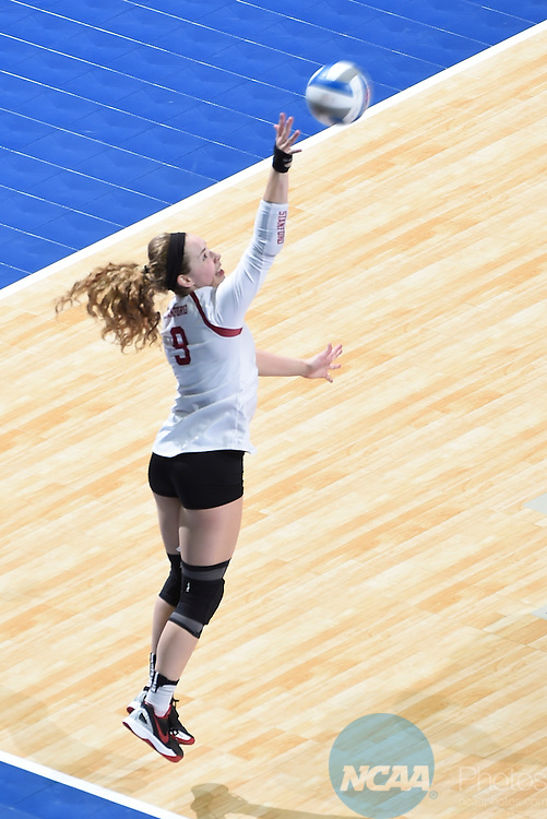 COLUMBUS, OH - DECEMBER 17:  Morgan Hentz (9) of Stanford University serves against the University of Texas during the Division I Women's Volleyball Championship held at Nationwide Arena on December 17, 2016 in Columbus, Ohio.  Stanford defeated Texas 3-1 to win the national title. (Photo by Jamie Schwaberow/NCAA Photos via Getty Images)