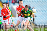 James Walsh of Kerry breaks away from Cork's Andrew O'Sullivan last Wednesday night in Pairc Ui Chaoimh, Cork in the Munster GAA Junior Football Championship.