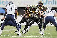 September 6, 2010; Hamilton, ON, CAN; Hamilton Tiger-Cats defensive back Jason Shivers (2), linebacker Otis Floyd (35) and linebacker Jamall Johnson (28). CFL football: Labour Day Classic - Toronto Argonauts vs. Hamilton Tiger-Cats at Ivor Wynne Stadium. The Tiger-Cats defeated the Argonauts 28-13. Mandatory Credit: Ron Scheffler.