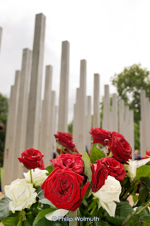 Roses at the 7/7 Monument in Hyde Park.  The memorial to the 52 people killed in the London bombings of 7 July 2005 was designed by architects Kevin Carmody and Andy Groarke.