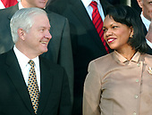 Washington, D.C. - January 3, 2007 -- United States Secretary of Defense Robert Gates, left, shares a smile with U.S. Secretary of State Condoleezza Rice, right, as they await U.S. President George W. Bush who made a statement after the first 2007 meeting of his Cabinet in the Rose Garden at the White House on Wednesday, January 3, 2007, in Washington, D.C.  In his remarks the President called on the new Democratic leaders in Congress to work with his administration.<br /> Credit: Ron Sachs / CNP