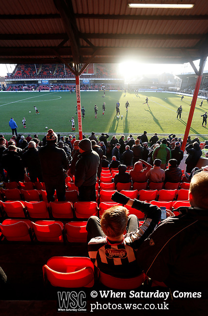 Grimsby Town 1 Lincoln City 3, 28/12/2014. Blundell Park, Football Conference. Watching the pre match warm up in the Main Stand.  Photo by Paul Thompson.