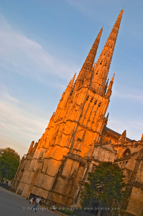 The Saint Andre Cathedral 11th 12th century with its majestic twin gothic towers in the evening at sunset strong sunlight on the place pey berland in Bordeaux diagonal city Bordeaux Gironde Aquitaine France