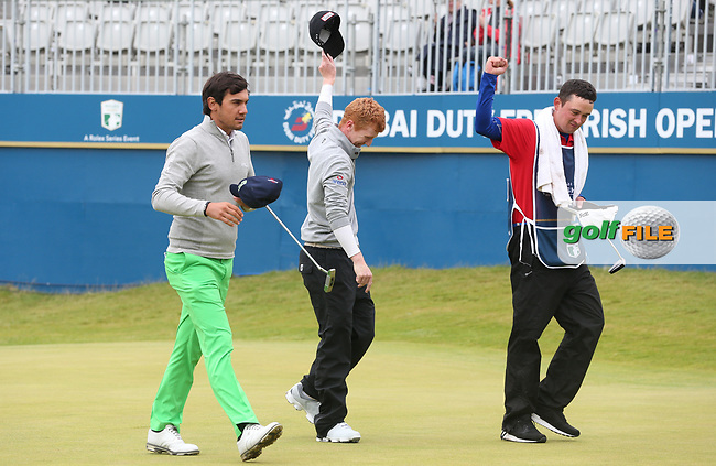 Feeling like heroes, /{prsn}/ and caddie celebrate a -13 leading score during the Final Round of the Dubai Duty Free Irish Open 2017 Hosted by the Rory Foundation, at Portstewart Golf Club, Derry, Northern Ireland.  09/07/2017. Picture: David Lloyd | Golffile.<br /> <br /> Images must display mandatory copyright credit - (Copyright: David Lloyd | Golffile).