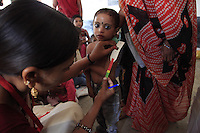 A child&rsquo;s upper arm is measured at an Anganwadi centre in the village of Baggad, in Madhya Pradesh&rsquo;s Dhar district. This is a quick and simple way to check if a child is severely underweight as they have a 10-30% chance of death without treatment.<br />
