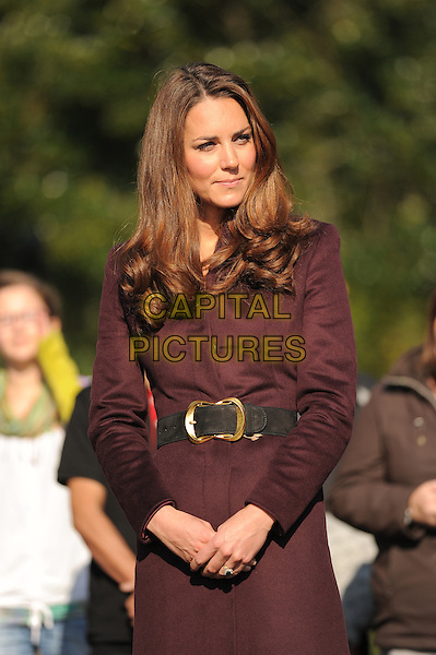 Catherine, Duchess of Cambridge.visiting Elswick Park. Newcastle, England..10th October 2012.Kate Middleton royal royalty half length brown coat jacket black belt maroon burgundy.CAP/CAS.©Bob Cass/Capital Pictures