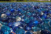 Switzerland. Blue glass pebbles in sunlight.