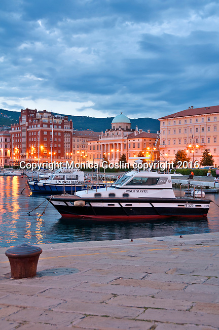 Molo Audace pier, looking towards downtown at sunset in Trieste, Italy