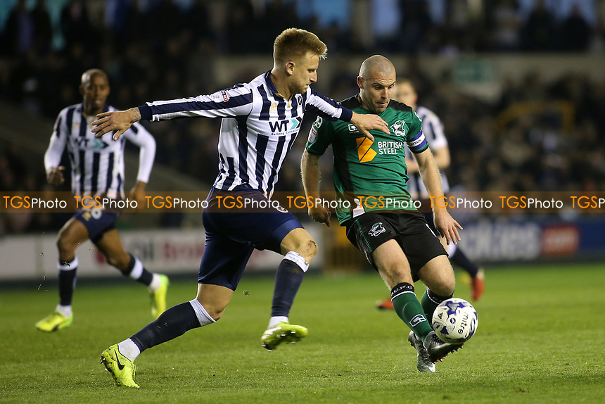 Stephen Dawson of Scunthorpe in possession as Millwall's Byron Webster gets ready to make a challenge during Millwall vs Scunthorpe United, Sky Bet EFL League 1 Play-Off Football at The Den on 4th May 2017