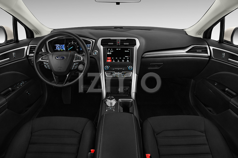 Stock photo of straight dashboard view of a 2018 Ford Fusion Hybrid SE 4 Door Sedan