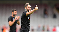 Lincoln City's assistant manager Nicky Cowley acknowledges the fans at the end of the game<br /> <br /> Photographer Chris Vaughan/CameraSport<br /> <br /> The EFL Sky Bet League Two - Lincoln City v Swindon Town - Saturday 11th August 2018 - Sincil Bank - Lincoln<br /> <br /> World Copyright &copy; 2018 CameraSport. All rights reserved. 43 Linden Ave. Countesthorpe. Leicester. England. LE8 5PG - Tel: +44 (0) 116 277 4147 - admin@camerasport.com - www.camerasport.com