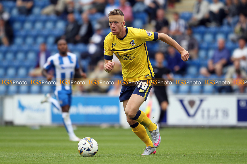 Kevin van Veen of Scunthorpe United runs with the ball during Colchester United vs Scunthorpe United, Sky Bet League 1 Football at the Weston Homes Community Stadium, Colchester, England on 29/08/2015