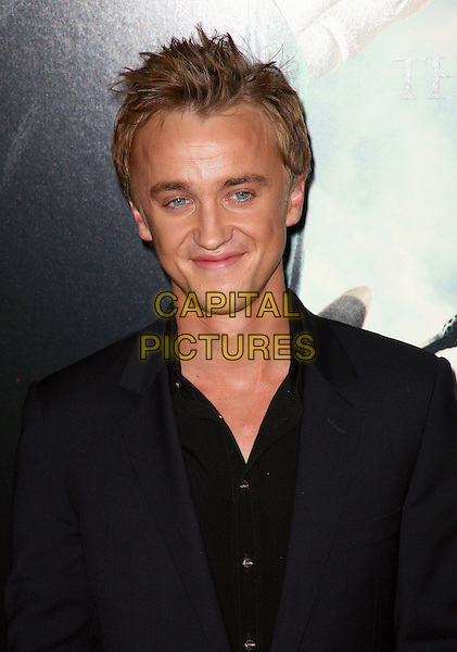 TOM FELTON .The premiere of 'Harry Potter and the Deathly Hallows - Part 1' at Alice Tully Hall in New York City, New York,  NY, USA, 15th November 2010..portrait headshot black shirt suit .CAP/ADM/PZ.©Paul Zimmerman/AdMedia/Capital Pictures.