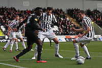 Victor Wanyama lays the ball off under pressure from Steven Thompson (centre) and Paul Dummett in the St Mirren v Celtic Clydesdale Bank Scottish Premier League match played at St Mirren Park, Paisley on 20.10.12.