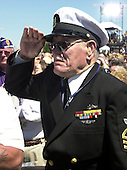Washington, D.C. - May 29, 2004 -- Edward Gaulrapp, a Pearl Harbor survivor, salutes during the dedication ceremony of the World War Two memorial in Washington, D.C.  on May 29, 2004. Gaulrapp was on a boat that rescued former President George H.W.Bush, whose plane was shot down in the Pacific during the war.  In his prepared remarks, United States President for contributing to America's 'greatest mission' at a ceremony to dedicate the new monument. .Credit: Ron Sachs / CNP