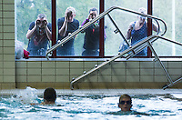 28 SEP 2014 - STOWMARKET, GBR - Spectators watch competitors in the pool during the swim for the 2014 West Suffolk Triathlon in Stowmarket in Suffolk, Great Britain (PHOTO COPYRIGHT © 2014 NIGEL FARROW, ALL RIGHTS RESERVED)