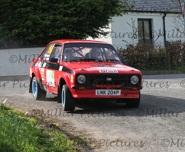 James Slaughter - Greg McCormack in a Ford Escort at Junction 13 on Special Stage 11 Bulls Brook on the Discover Northern Ireland Circuit of Ireland Rally which was a constituent round of  the FIA European Rally Championship, the FIA Junior European Rally Championship, the Clonakilty Irish Tarmac Rally Championship, and the MSA ANICC Northern Ireland Stage Rally Championships which took place on 18.4.14 and 19.4.14 and was based in Belfast.