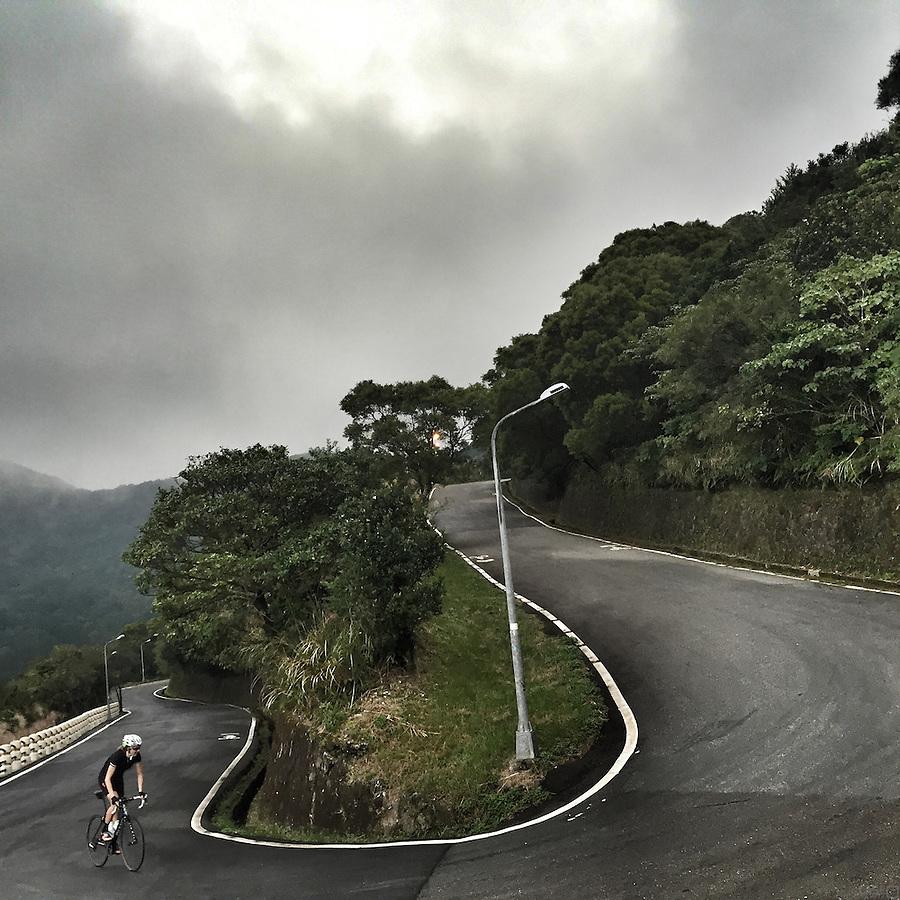 Cycling among the switchbacks in Yangmingshan National Park, near Taipei, Taiwan.