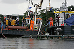 The Keil of the fishing vessel dates from about 1500 A.D being lifted from the bottom of the river boyne in Drogheda..Photo: Newsfile/Fran Caffrey..The National Monuments service with the national Museum of Ireland and the Drogheda Port Company will oversaw the recovery of the medieval sailing vessel discovered during the course of dredging operations in the river boyne late last year...The find has surpassed all initial expectations in terms of the amount of recoverable material. Carbon dating analysis of some of the vessel?s timbers indicate that dates from about 1500 A.D. Further analysis should be able to pinpoint its dating to within a couple of decades...The wreck was first discovered in late November 2006 during dredging operations being undertaken in the River Boyne by Drogheda Port Company. The accidental discovery has generated great interest, because it is the first such discovery in Ireland and much of the wreck is intact. The wreck lies within Drogheda port and is some 12 metres in length. The location of the vessel in mid-stream of the fast flowing River Boyne means that it was impracticable to leave the vessel to be preserved in situ.  The wreck has now been fully archaeologically excavated to best international standards by an archaeological team from the Department of Environment supported by the Drogheda Port company. Having excavated and recorded the wreck to the fullest extent possible the team will now seek to recover as much of the wreck as possible on a timber by timber basis.  The wreck will be conserved for further analysis and ultimately it is hoped to put it on public display...The final phase of the recovery operation on the wreck will, as heretofore, be overseen by the National Monuments Service in co-operation with conservation experts from the National Museum of Ireland and with logistical support from Drogheda Port Company...As well as the vessel itself, the find also includes a number of very well preserved cargo barrels, rigging com