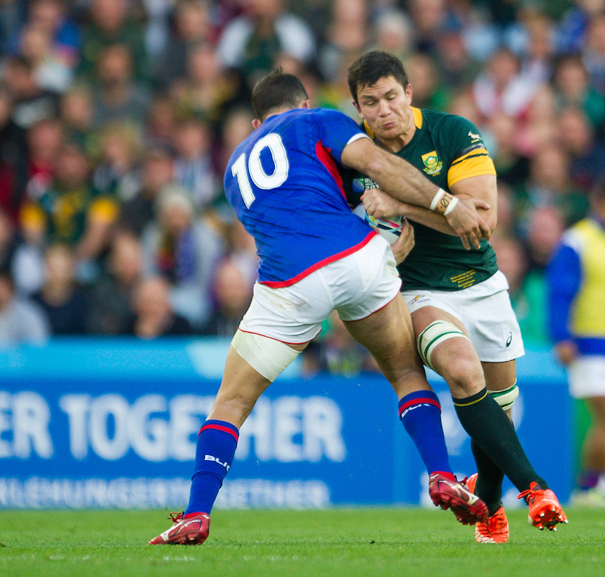 South Africa's Francois Louw is tackled by Samoa's Mike Stanley<br /> <br /> Photographer Craig Thomas /CameraSport<br /> <br /> Rugby Union - 2015 Rugby World Cup Pool B  South Africa v Samoa - Saturday 26th September 2015 - Villa Park - Birmingham<br /> <br /> &copy; CameraSport - 43 Linden Ave. Countesthorpe. Leicester. England. LE8 5PG - Tel: +44 (0) 116 277 4147 - admin@camerasport.com - www.camerasport.com