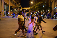 Black Lives Matter protesters marched with their families and friends as police cordoned South State Street in the South Loop in Chicago, Illinois on July 9, 2016.  Protests erupted nationwide following the police shootings of Alton Sterling who was selling bootleg DVDs outside a convenience store in Baton Rouge, Louisiana and Philando Castile during a routine traffic stop for a broken tail light in the St. Paul, Minneapolis suburb of Falcon Heights; on Thursday night, a lone gunman Micah Johnson fired and killed five police officers and injured several others during a Black Lives Matter protest in Dallas.