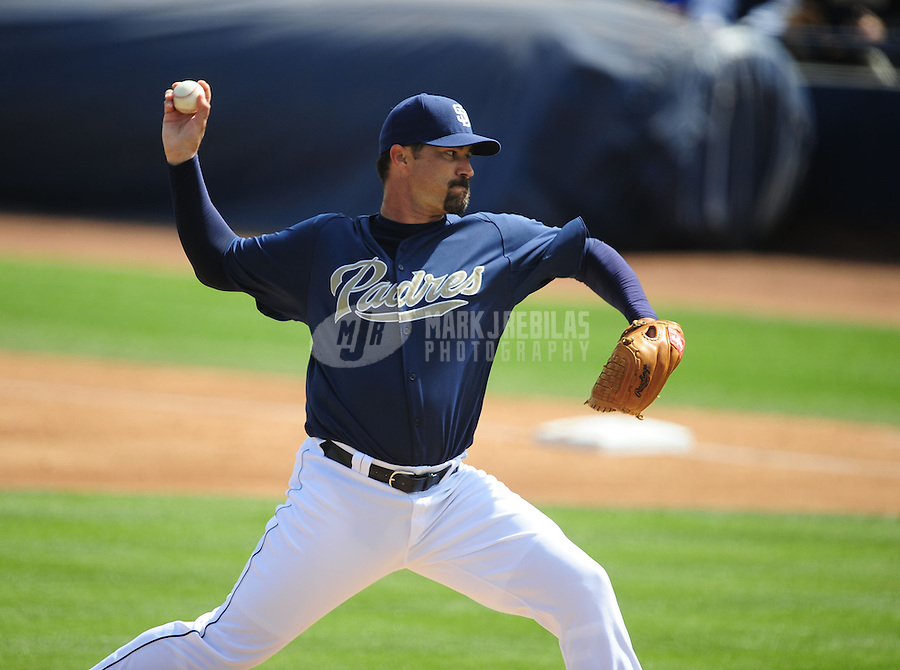 Mar. 7, 2012; Peoria, AZ, USA; San Diego Padres pitcher Jeff Suppan throws against the Texas Rangers during the second inning at Peoria Stadium.  Mandatory Credit: Mark J. Rebilas-.