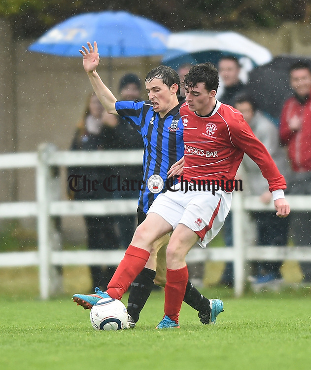 Derek Fahy of Bridge United in action against Ian Collins of Newmarket Celtic during their Cup final at Doora. Photograph by John Kelly.